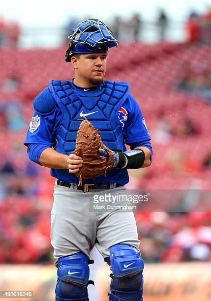 Kyle Schwarber of the Chicago Cubs looks on while wearing Nike catchers gear during the game against the Cincinnati Reds at Great American Ball Park...