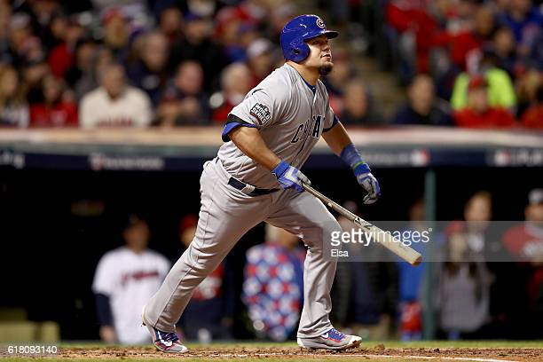 Kyle Schwarber of the Chicago Cubs reacts after hitting a double during the fourth inning against the Cleveland Indians in Game One of the 2016 World...