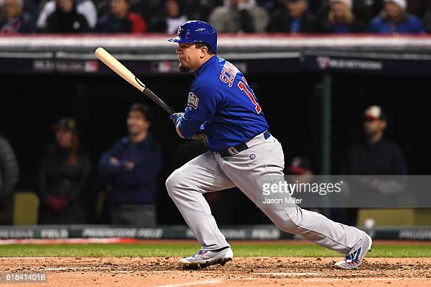 Kyle Schwarber of the Chicago Cubs reacts after hitting an RBI single to score Anthony Rizzo during the third inning against the Cleveland Indians in...