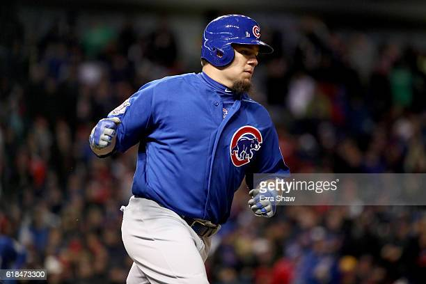 Kyle Schwarber of the Chicago Cubs reacts after hitting an RBI single to score Ben Zobrist during the fifth inning against the Cleveland Indians in...