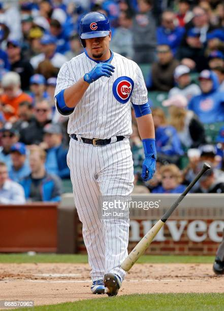 Kyle Schwarber of the Chicago Cubs reacts after striking out against the Pittsburgh Pirates to end the third inning at Wrigley Field on April 14 2017...