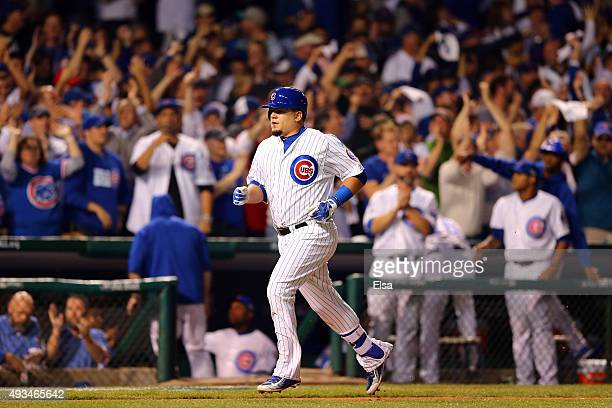 Kyle Schwarber of the Chicago Cubs rounds the bases after hitting a solo home run in the first inning against Jacob deGrom of the New York Mets...