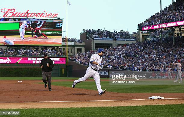 Kyle Schwarber of the Chicago Cubs runs the bases after hitting a solo home run in the second inning against the St Louis Cardinals during game three...