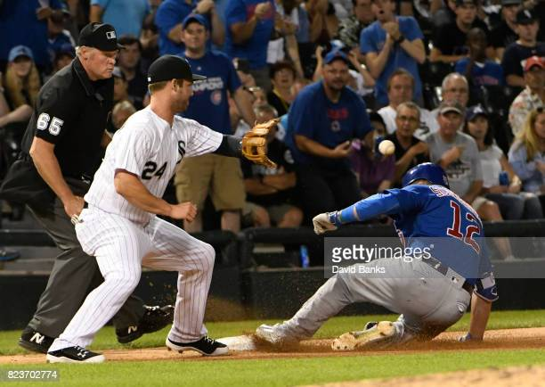 Kyle Schwarber of the Chicago Cubs slides safely into third base with a triple as Matt Davidson of the Chicago White Sox takes the late throw during...