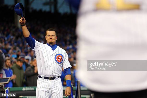 Kyle Schwarber of the Chicago Cubs takes the field during the World Series ring ceremony ahead of the game between the Los Angeles Dodgers and the...