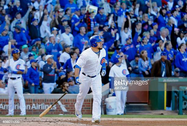 Kyle Schwarber of the Chicago Cubs watches his two run home run against the Cincinnati Reds during the second inning at Wrigley Field on September 30...