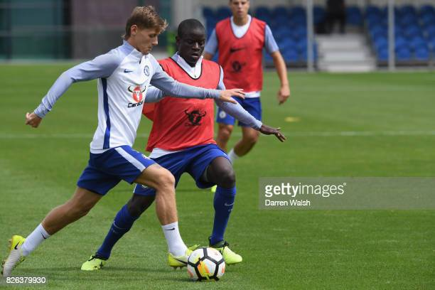 Kyle Scott and N'Golo Kante of Chelsea during a training session at Chelsea Training Ground on August 4 2017 in Cobham England