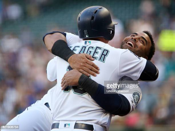 Kyle Seager of the Seattle Mariners gets a hug from Nelson Cruz after hitting a solo home run in the second inning against the Boston Red Sox at...