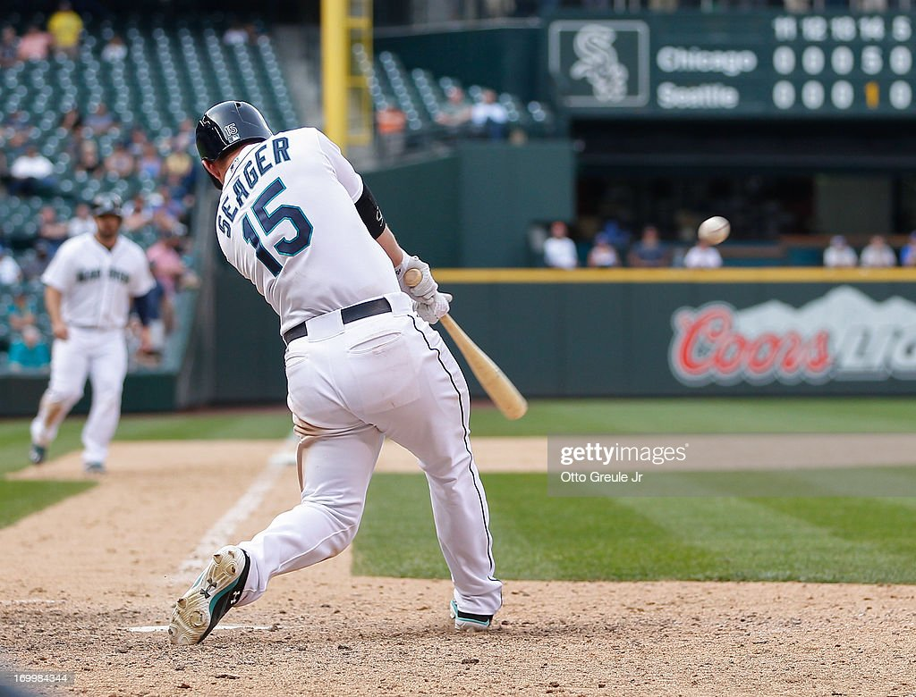 <a gi-track='captionPersonalityLinkClicked' href=/galleries/search?phrase=Kyle+Seager&family=editorial&specificpeople=7682389 ng-click='$event.stopPropagation()'>Kyle Seager</a> #15 of the Seattle Mariners hits a grand slam to tie the game in the fourteenth inning against the Chicago White Sox at Safeco Field on June 5, 2013 in Seattle, Washington.