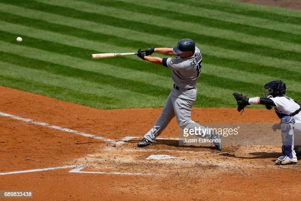 Kyle Seager of the Seattle Mariners hits a two RBI double in the fifth inning against the Colorado Rockies during interleague play at Coors Field on...
