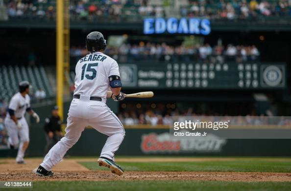 Kyle Seager of the Seattle Mariners hits a tworun double in the seventh inning against the San Diego Padres at Safeco Field on June 17 2014 in...
