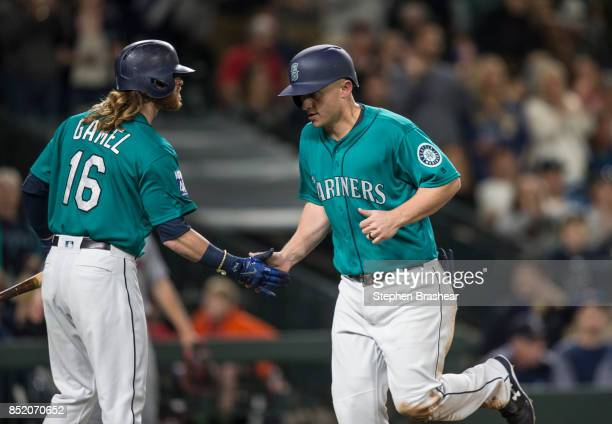 Kyle Seager of the Seattle Mariners is congratulated by Ben Gamel of the Seattle Mariners after scoring a run on a single by Yonder Alonso of the...