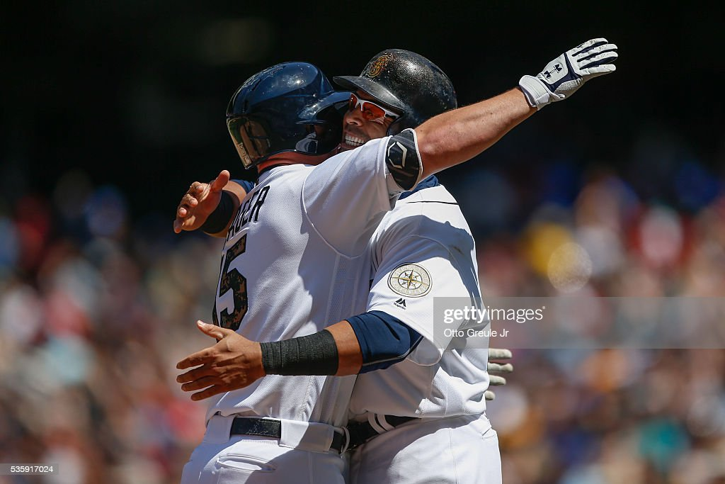 <a gi-track='captionPersonalityLinkClicked' href=/galleries/search?phrase=Kyle+Seager&family=editorial&specificpeople=7682389 ng-click='$event.stopPropagation()'>Kyle Seager</a> #15 (L) of the Seattle Mariners is congratulated by <a gi-track='captionPersonalityLinkClicked' href=/galleries/search?phrase=Nelson+Cruz&family=editorial&specificpeople=235459 ng-click='$event.stopPropagation()'>Nelson Cruz</a> #23 after hitting two-run home run against the San Diego Padres in the sixth inning at Safeco Field on May 30, 2016 in Seattle, Washington.
