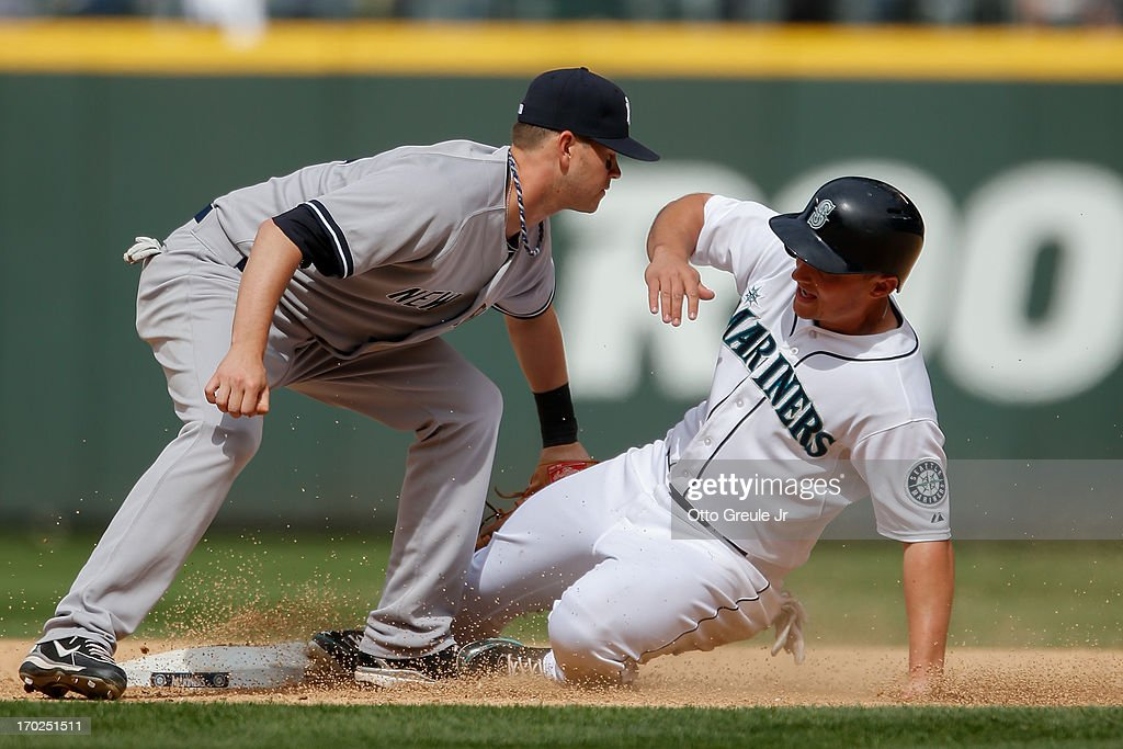 <a gi-track='captionPersonalityLinkClicked' href=/galleries/search?phrase=Kyle+Seager&family=editorial&specificpeople=7682389 ng-click='$event.stopPropagation()'>Kyle Seager</a> #15 of the Seattle Mariners is put out at second by shortstop <a gi-track='captionPersonalityLinkClicked' href=/galleries/search?phrase=Reid+Brignac&family=editorial&specificpeople=4175431 ng-click='$event.stopPropagation()'>Reid Brignac</a> #40 of the New York Yankees on a double play in the ninth inning at Safeco Field on June 9, 2013 in Seattle, Washington. The Yankees defeated the Mariners 2-1.