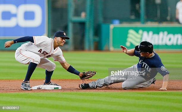 Kyle Seager of the Seattle Mariners is tagged out by Carlos Correa of the Houston Astros trying to steal second base in the first inning at Minute...