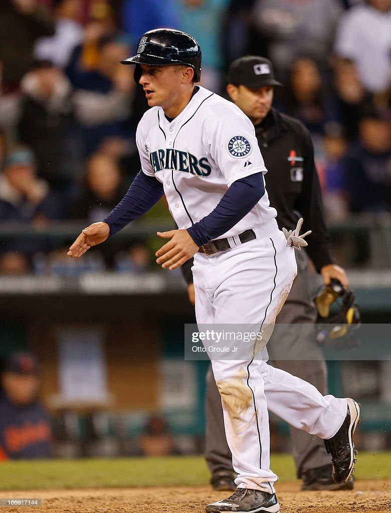 Kyle Seager #15 of the Seattle Mariners reacts after scoring on an RBI single by Endy Chavez against the Detroit Tigers in the seventh inning at Safeco Field on April 18, 2013 in Seattle, Washington. The Mariners defeated the Tigers 2-0.