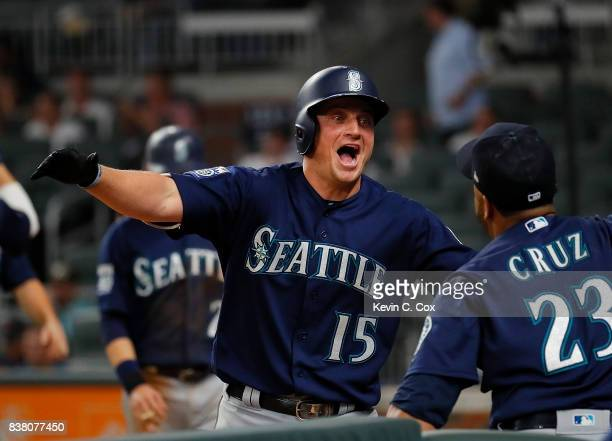 Kyle Seager of the Seattle Mariners reacts with Nelson Cruz after hitting a threerun homer in the eighth inning to score Taylor Motter and Danny...