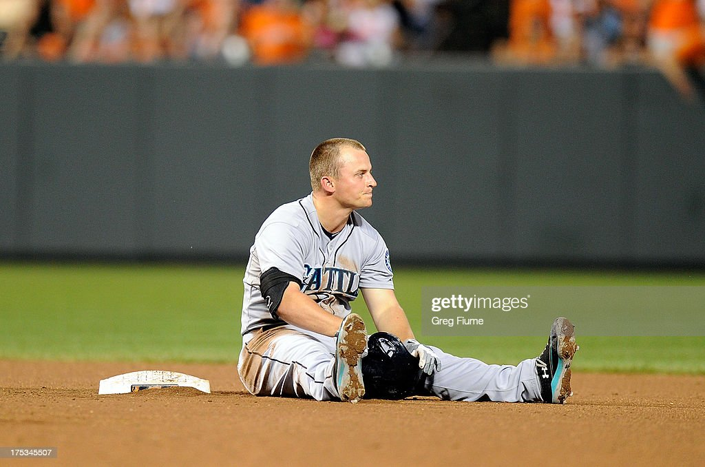 <a gi-track='captionPersonalityLinkClicked' href=/galleries/search?phrase=Kyle+Seager&family=editorial&specificpeople=7682389 ng-click='$event.stopPropagation()'>Kyle Seager</a> #15 of the Seattle Mariners sits in the infield after being thrown out at second base in the seventh inning against the Baltimore Orioles at Oriole Park at Camden Yards on August 2, 2013 in Baltimore, Maryland.