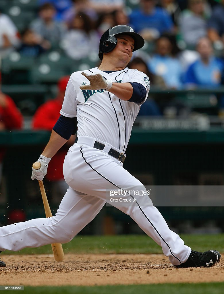 <a gi-track='captionPersonalityLinkClicked' href=/galleries/search?phrase=Kyle+Seager&family=editorial&specificpeople=7682389 ng-click='$event.stopPropagation()'>Kyle Seager</a> #15 of the Seattle Mariners swings and misses in the seventh inning against the Los Angeles Angels of Anaheim at Safeco Field on April 28, 2013 in Seattle, Washington. Seager was hitless on the day, ending his hitting streak at 16 games.
