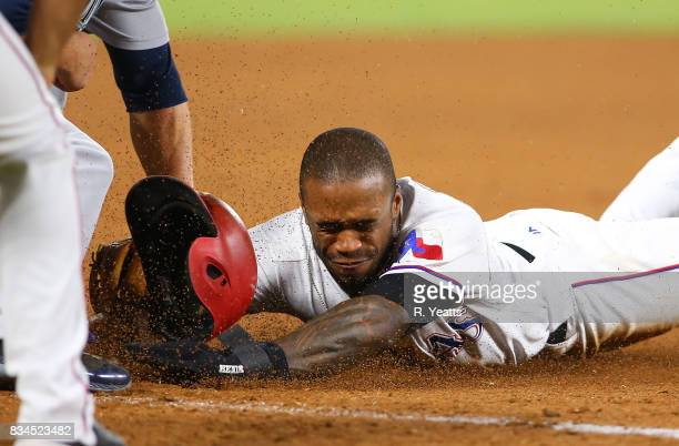 Kyle Seager of the Seattle Mariners tags out Delino DeShields of the Texas Rangers on third base in the eighth inning at Globe Life Park in Arlington...