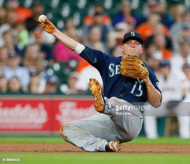 Kyle Seager of the Seattle Mariners throws to first base but unable to retire Jose Altuve of the Houston Astros in the third inning at Minute Maid...