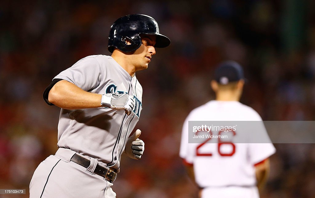 Kyle Seager #15 of the Seattle Mariners trots around the bases after hitting a solo home run in the 7th inning against the Boston Red Sox during the game on July 31, 2013 at Fenway Park in Boston, Massachusetts.