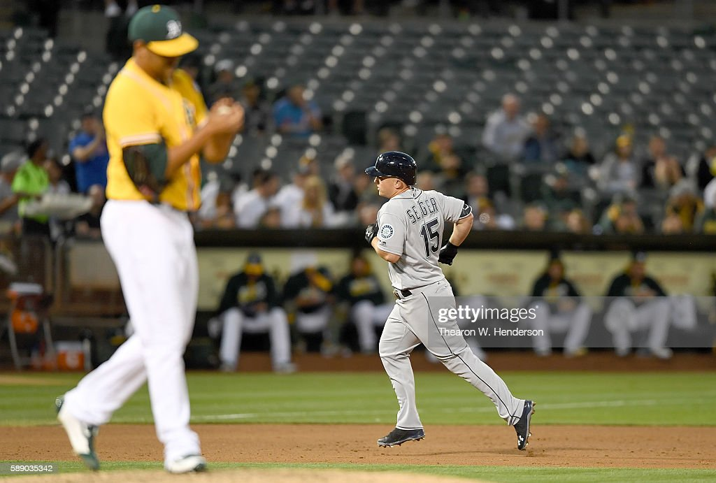 Kyle Seager #15 of the Seattle Mariners trots around the bases after hitting a solo home run off of Sean Manaea #55 of the Oakland Athletics in the top of the fifth inning at the Oakland Coliseum on August 12, 2016 in Oakland, California.