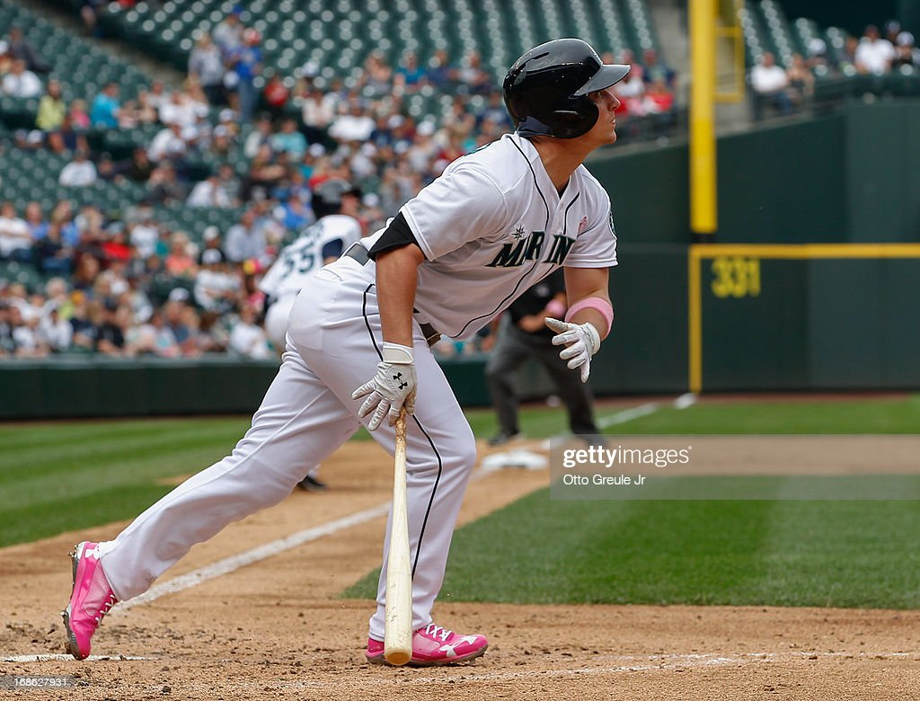 <a gi-track='captionPersonalityLinkClicked' href=/galleries/search?phrase=Kyle+Seager&family=editorial&specificpeople=7682389 ng-click='$event.stopPropagation()'>Kyle Seager</a> #15 of the Seattle Mariners watches his sacrifice fly in the fifth inning against the Oakland Athletics at Safeco Field on May 12, 2013 in Seattle, Washington. Michael Saunders scored from third on the play.