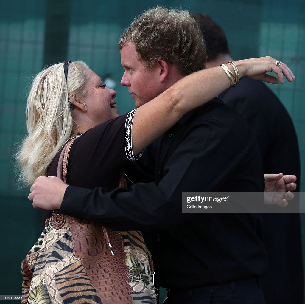 Kyle Shepard with his mother outside court after his bail application on April 8, 2013 in Durban, South Africa. Shepard is one of the accused charged with the murder of a British Royal Marine, Brett Williams. Williams was beaten to death at a Super XV Match at Durban Stadium.