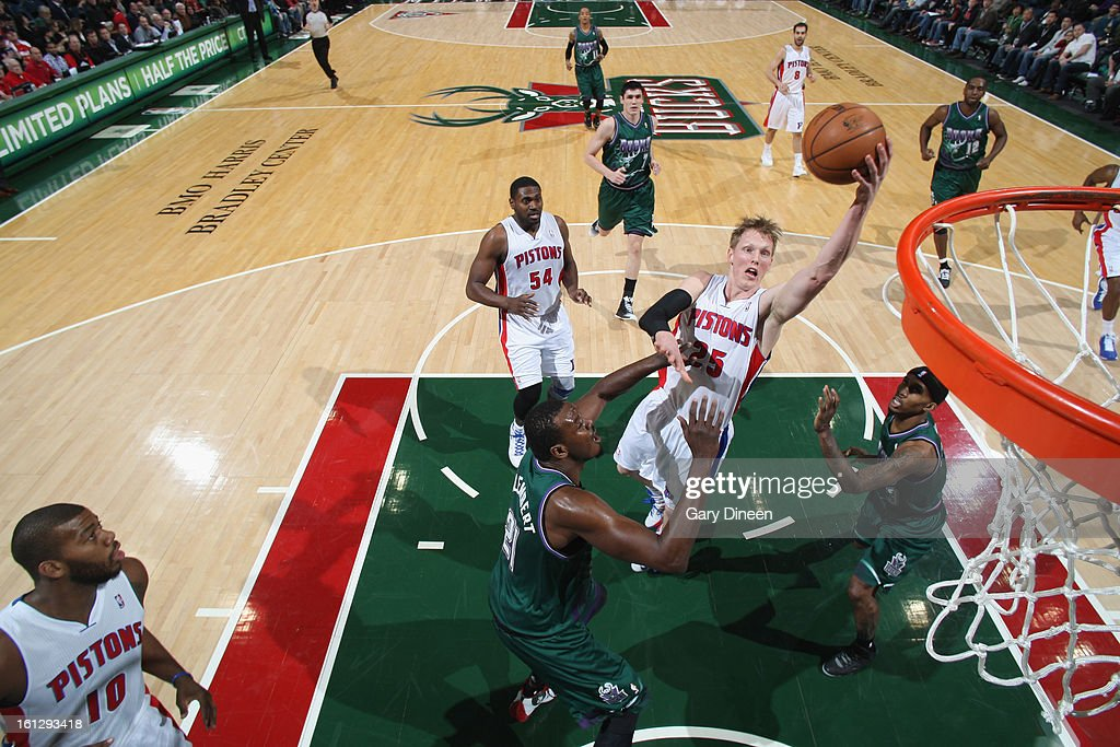 Kyle Sigler #25 of the Detroit Pistons shoots against (L-R) <a gi-track='captionPersonalityLinkClicked' href=/galleries/search?phrase=Samuel+Dalembert&family=editorial&specificpeople=202026 ng-click='$event.stopPropagation()'>Samuel Dalembert</a> #21 and Brandon Jennings #3 of the Milwaukee Bucks on February 9, 2013 at the BMO Harris Bradley Center in Milwaukee, Wisconsin.