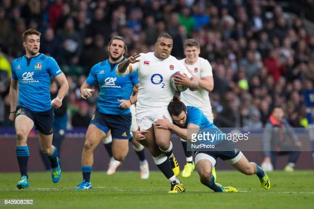 Kyle Sinckler of England is tackled by Michele Campagnaro of Italy during the RBS 6 Nations match between England and Italy at Twickenham Stadium on...