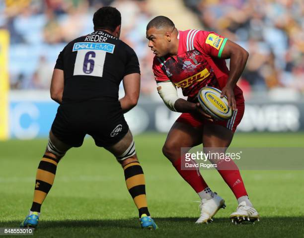 Kyle Sinckler of Harlequins takes on Alex Rieder during the Aviva Premiership match between Wasps and Harlequins at The Ricoh Arena on September 17...