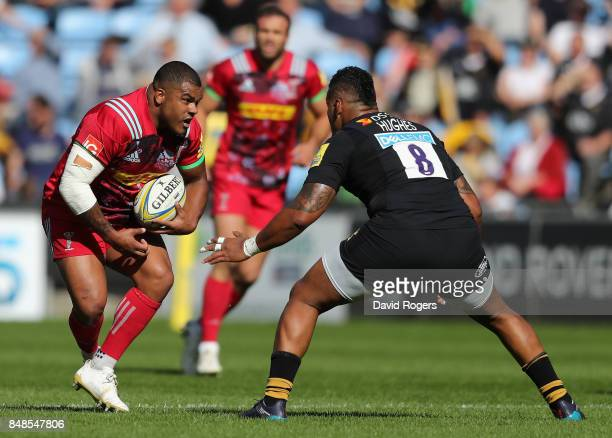 Kyle Sinckler of Harlequins takes on Nathan Hughes during the Aviva Premiership match between Wasps and Harlequins at The Ricoh Arena on September 17...