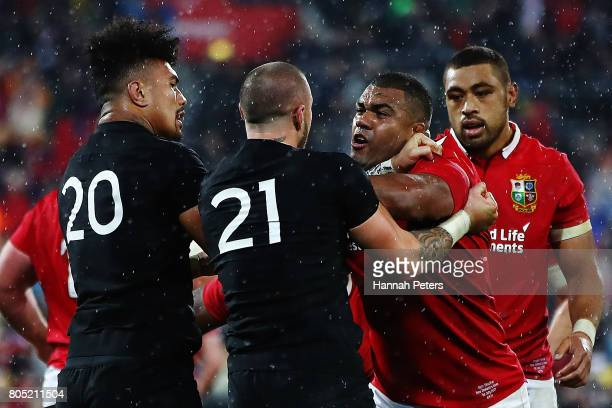 Kyle Sinckler of the Lions fights with Ardie Savea and TJ Perenara of the All Blacks after winning the International Test match between the New...