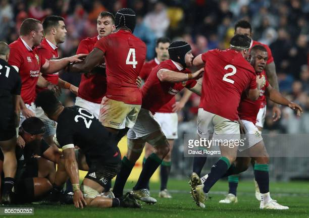 Kyle Sinckler of the Lions is mobbed by team mates after winning a late penalty during the match between the New Zealand All Blacks and the British...