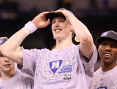 Kyle Singler and Nolan Smith of the Duke Blue Devils celebrate after the Blue Devils defeat the Butler Bulldogs 6159 in the 2010 NCAA Division I...