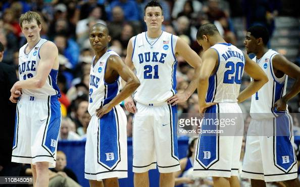 Kyle Singler Nolan Smith Miles Plumlee Andre Dawkins and Kyrie Irving of the Duke Blue Devils looks on against the Arizona Wildcats during the west...