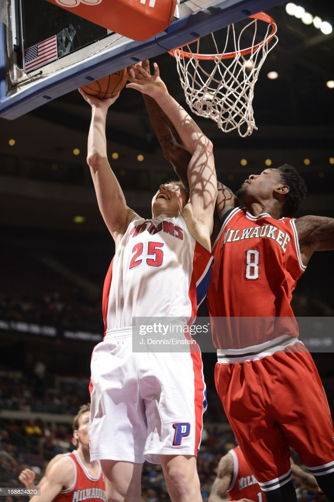<a gi-track='captionPersonalityLinkClicked' href=/galleries/search?phrase=Kyle+Singler&family=editorial&specificpeople=4216029 ng-click='$event.stopPropagation()'>Kyle Singler</a> #25 of the Detroit Pistons and Larry Sanders #8 of the Milwaukee Bucks battle for the ball control during the game between the Detroit Pistons and the Milwaukee Bucks on December 30, 2012 at The Palace of Auburn Hills in Auburn Hills, Michigan.