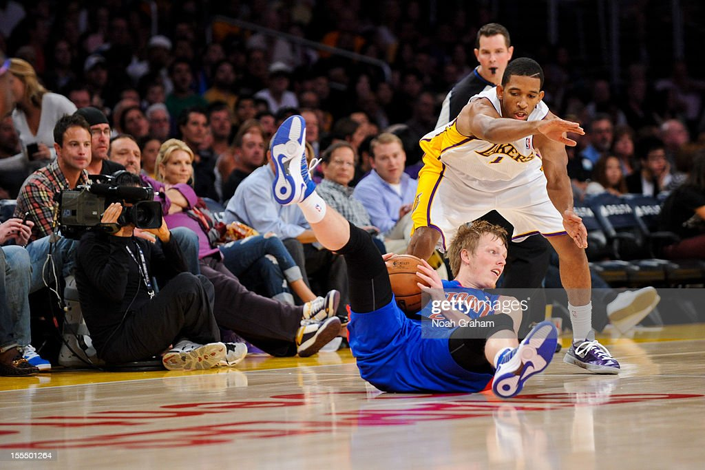 <a gi-track='captionPersonalityLinkClicked' href=/galleries/search?phrase=Kyle+Singler&family=editorial&specificpeople=4216029 ng-click='$event.stopPropagation()'>Kyle Singler</a> #25 of the Detroit Pistons controls a loose ball against Darius Morris #1 of the Los Angeles Lakers at Staples Center on November 4, 2012 in Los Angeles, California.