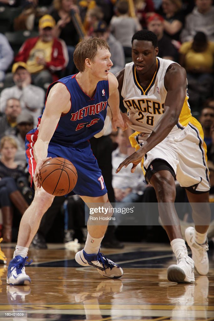 Kyle Singler #25 of the Detroit Pistons controls the ball against Ian Mahinmi #28 of the Indiana Pacers on January 30, 2013 at Bankers Life Fieldhouse in Indianapolis, Indiana.