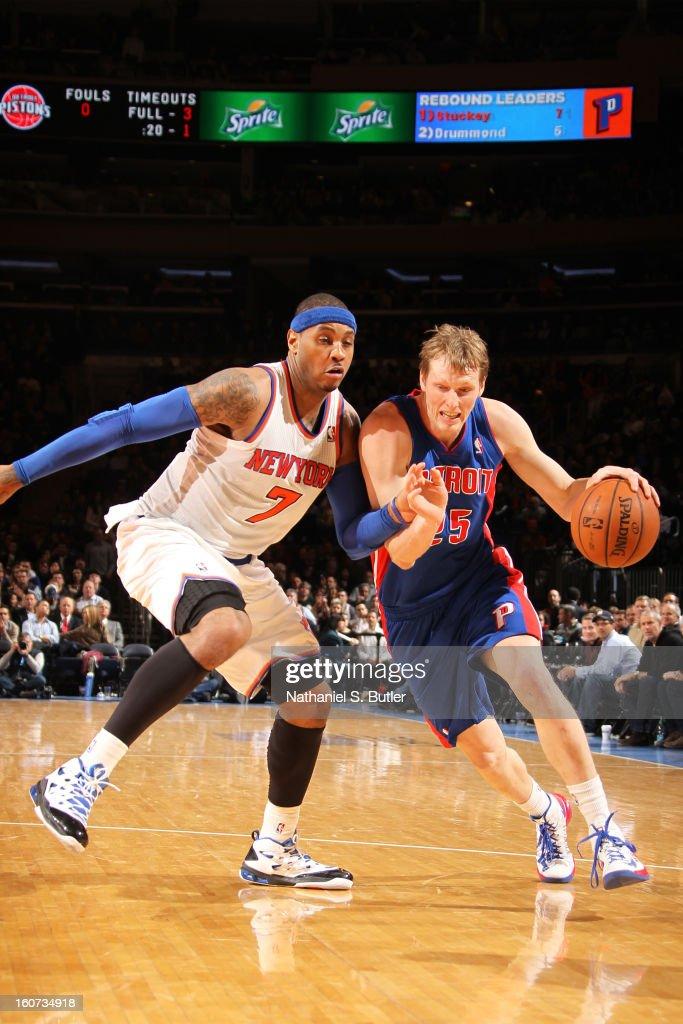 Kyle Singler #25 of the Detroit Pistons dribbles against Carmelo Anthony #7 of the New York Knicks on February 4, 2013 at Madison Square Garden in New York City.