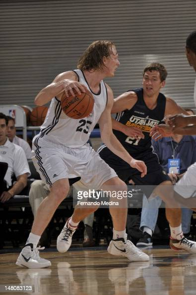 Kyle Singler of the Detroit Pistons dribbles against Michael Stockton of the Utah Jazz during the 2012 Air Tran Airways Orlando Pro Summer League on...