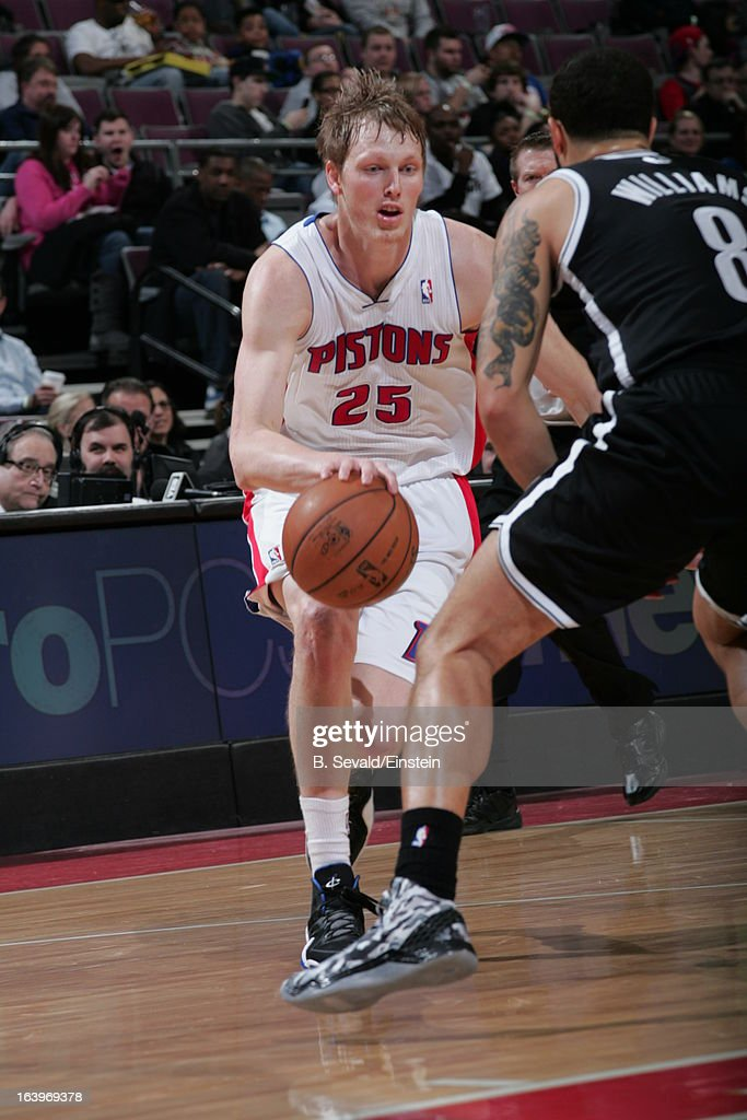 Kyle Singler #25 of the Detroit Pistons drives against Deron Williams #8 of the Brooklyn Nets on March 18, 2013 at The Palace of Auburn Hills in Auburn Hills, Michigan.
