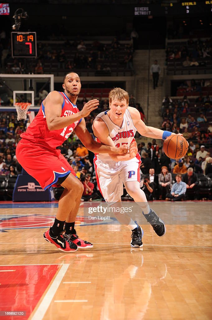Kyle Singler #25 of the Detroit Pistons drives against Evan Turner #12 of the Philadelphia 76ers during the game between the Detroit Pistons and the Philadelphia 76ers on April 15, 2013 at The Palace of Auburn Hills in Auburn Hills, Michigan.