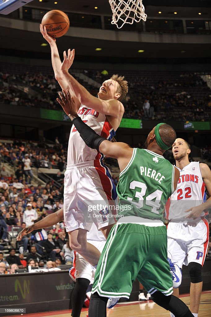 Kyle Singler #25 of the Detroit Pistons drives to the basket against Paul Pierce #34 of the Boston Celtics on January 20, 2013 at The Palace of Auburn Hills in Auburn Hills, Michigan.