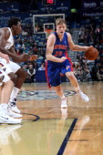 Kyle Singler of the Detroit Pistons drives to the basket against the New Orleans Pelicans during an NBA game on December 11 2013 at the New Orleans...