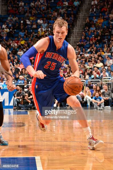 Kyle Singler of the Detroit Pistons drives to the basket against the Orlando Magic on December 30 2014 at Amway Center in Orlando Florida NOTE TO...