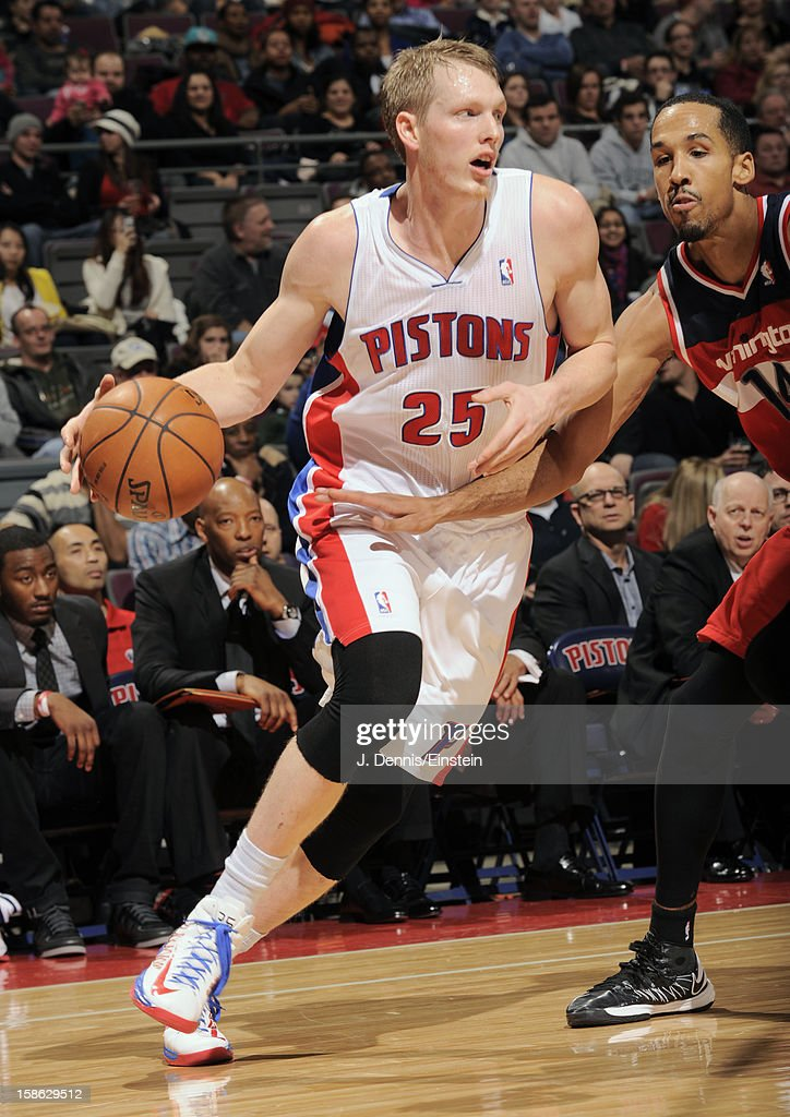 Kyle Singler #25 of the Detroit Pistons drives to the hole against the Washington Wizards during the game on December 21, 2012 at The Palace of Auburn Hills in Auburn Hills, Michigan.