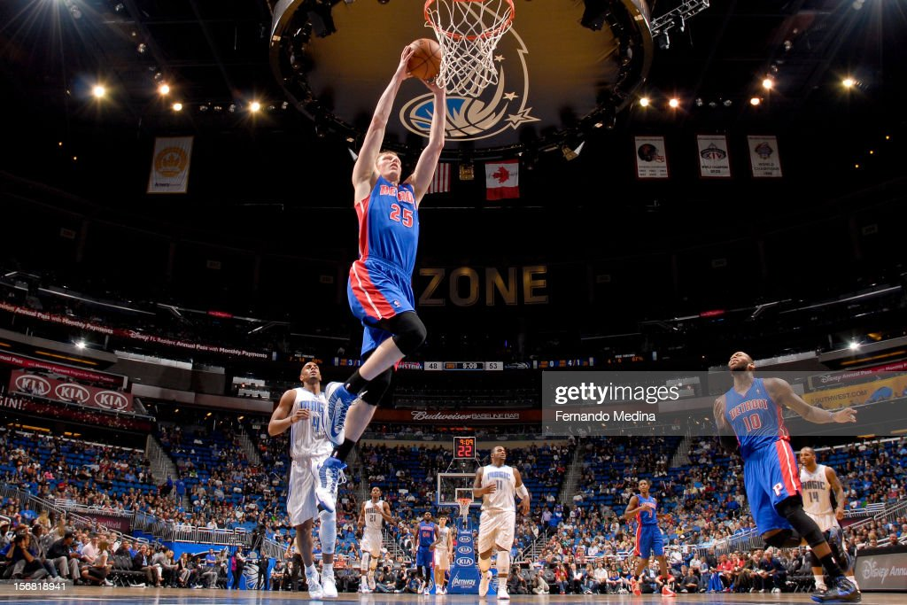 Kyle Singler #25 of the Detroit Pistons dunks against the Orlando Magic on November 21, 2012 at Amway Center in Orlando, Florida.