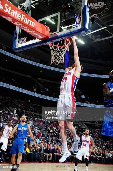 Kyle Singler of the Detroit Pistons dunks against the Orlando Magic during the game on November 17 2014 at The Palace of Auburn Hills in Auburn Hills...